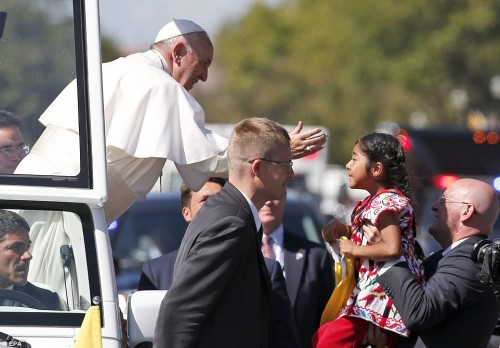 2CAEF40F00000578-3245930-Another_child_was_carried_over_to_the_Popemobile_for_a_kiss_as_t-a-30_1443027214072
